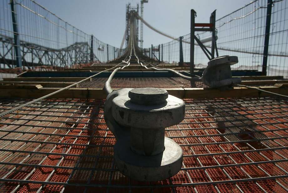 Heavy duty hardware and cable run the length of a catwalk which will facilitate the construction of the world's largest self-anchored suspension bridge at the Bay Bridge project. Photo: Mathew Sumner, Special To The Chronicle
