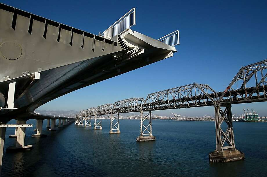A section of the newly constructed eastern span of the San Francisco-Oakland Bay Bridge is seen next to the existing bridge during a media tour of the self-anchored suspension span tower on August 29, 2011 in Oakland, California. Photo: Justin Sullivan, Getty Images