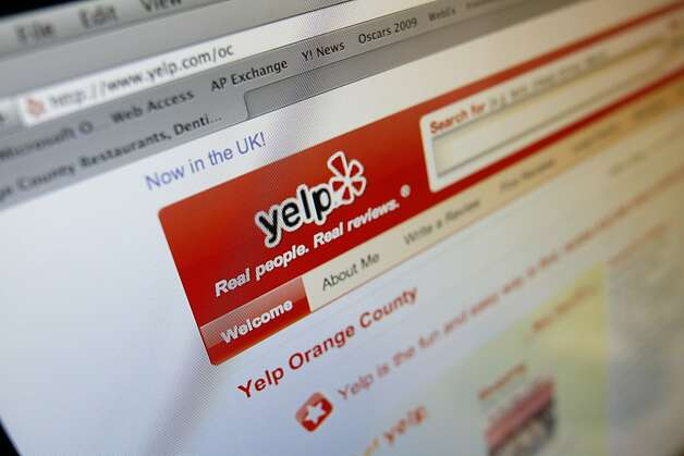 FILE - In this March 17, 2010 file photo, the Yelp Web site is shown on a computer screen in Los Angeles. Yelp now letting visitors see those that are automatically filtered out by software meant to catch content that isn't trustworthy. (AP Photo/Richard Vogel, File)    Ran on: 04-07-2010 Yelp, which posts opinions about restaurants and businesses, will let visitors see all the reviews. Ran on: 04-07-2010 Yelp, which posts opinions about restaurants and businesses, will let visitors see all the reviews.  Ran on: 05-07-2010 Yelp, the Web site that lets users post reviews, says it is already popular in Ireland and Britain. Ran on: 05-07-2010 Yelp, the Web site that lets users post reviews, says it is already popular in Ireland and Britain. Photo: Richard Vogel, AP