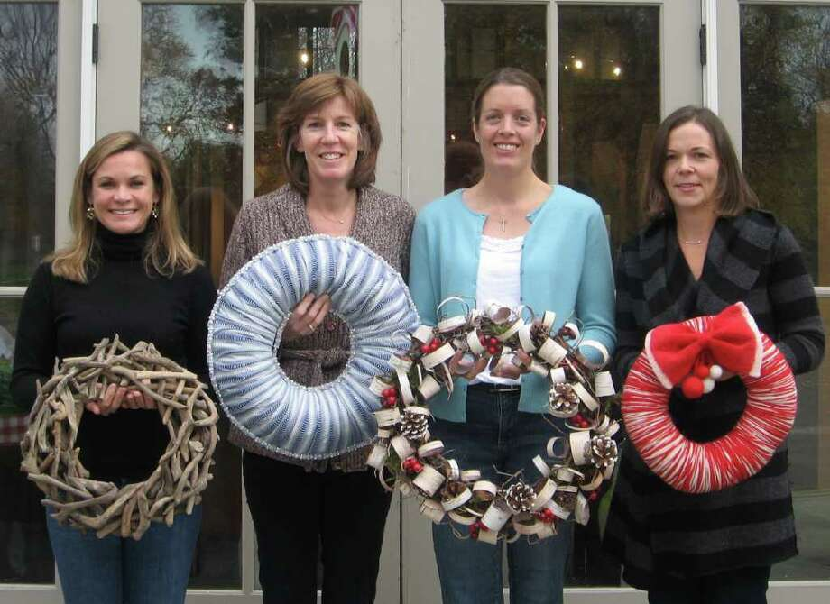 Darien Nature Center Festival of Wreaths co-chairmen Alison Moffatt, Amy Powless, Ryann Pegler and Michele Sini, get in the holiday spirit for the upcoming 10th anniversary of Festival of Wreaths. Photo: Contributed Photo