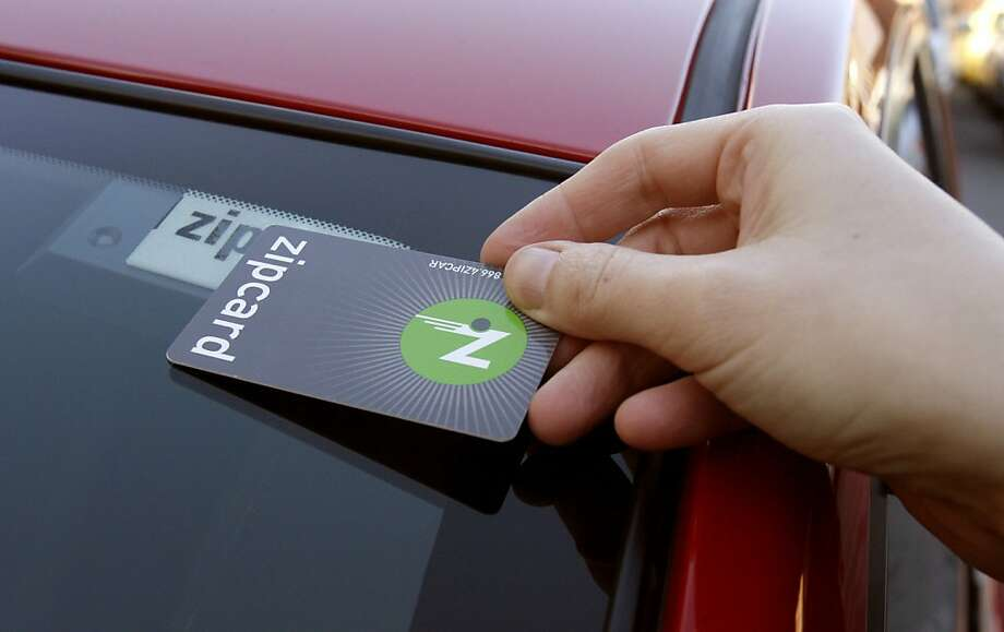 carshare_0005_db.JPG Tara Hunt of San Francisco, swipes her card to a reader under the windshield that unlucks the car, for her to drive, as she begins to drive in a Nissan Versa, one of many Zipcars she uses from the car share service in San Francisco, CA, on Wednesday, January, 17, 2007.  photo taken: 1/17/07 Darryl Bush / The Chronicle    ** Tara Hunt (cq)    Ran on: 11-29-2011 Zipcar customers in San Francisco and Oakland now have six cargo vans available, and soon 15. Photo: Darryl Bush, The Chronicle 2007