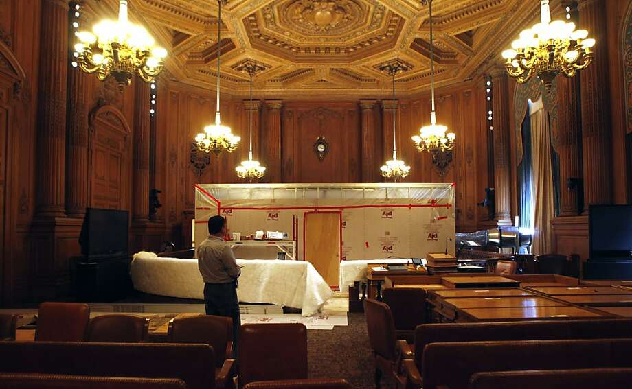 Robert Ritter City Hall's building manager stands in the center of the supervisors chambers. A temporary containment room has been built in the center of the city of San Francisco board of supervisors chambers to mitigate dust as the city builds a new wheel chair ramp costing the tax payers over $699,000 to install. Photo: Lance Iversen, The Chronicle