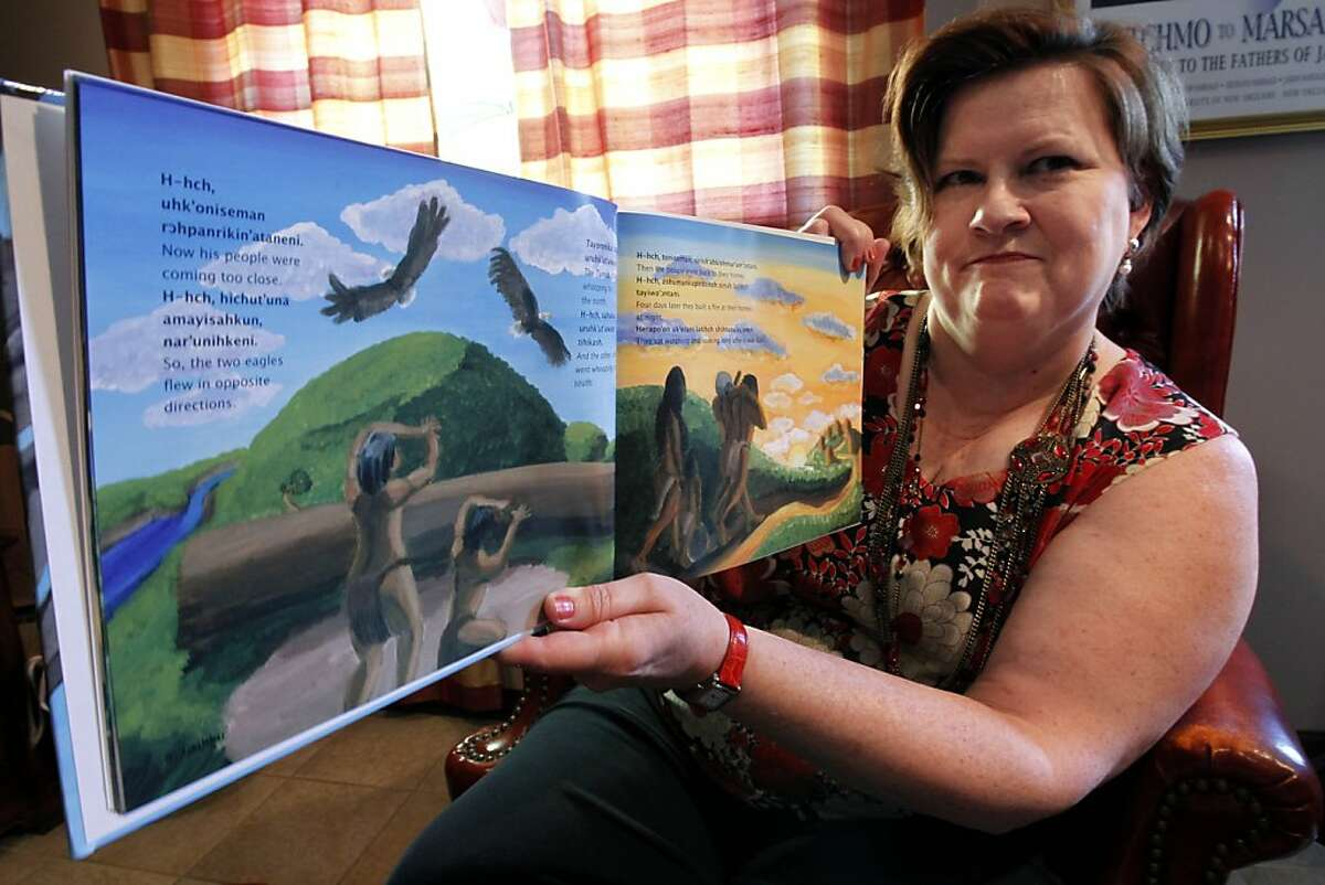 In this Aug. 5, 2011 photo, Brenda Lintinger poses with one of her children's books she wrote in the Tunica Indian language, in her home in Metairie, La. Lintinger decided to do more than learn a new language: she set out to resurrect the ancient tongue of her own Tunica Indian tribe, words that had not been uttered for more than 60 years. (AP Photo/Gerald Herbert) Ran on: 08-28-2011 Brenda Lintinger shows one of the children's books she wrote in the previously dead Tunica language.