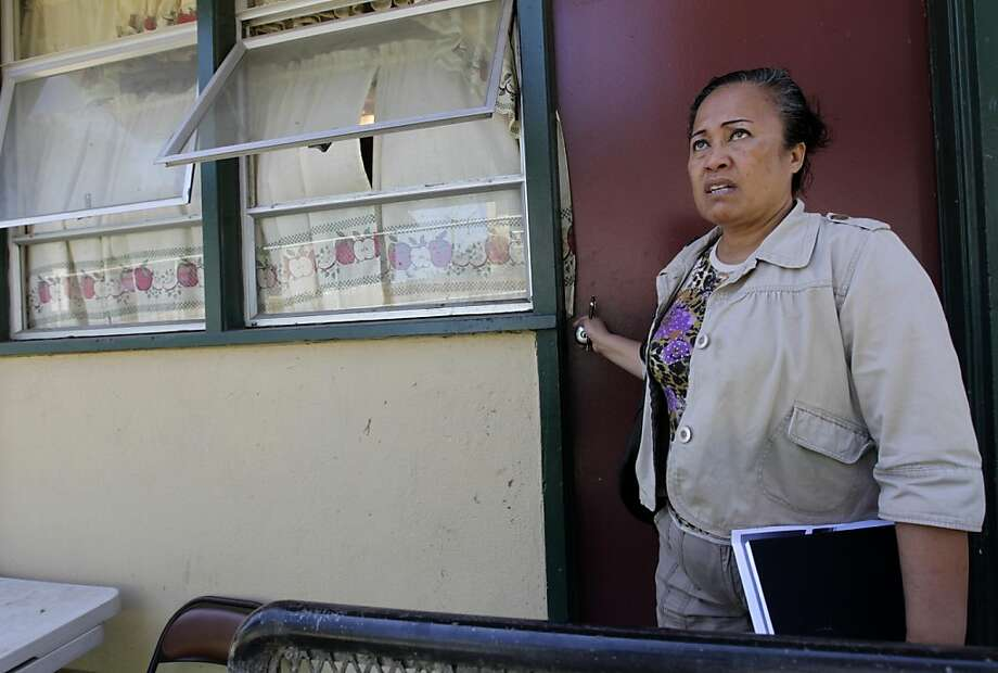 Community activist Fala Satele looks out at her neighborhood from the back door of her home at the Alice Griffith housing project in San Francisco, Calif. on Tuesday, August 30, 2011. The housing authority has received a $30 million federal grant to help subsidize a major renovation project. Photo: Paul Chinn, The Chronicle