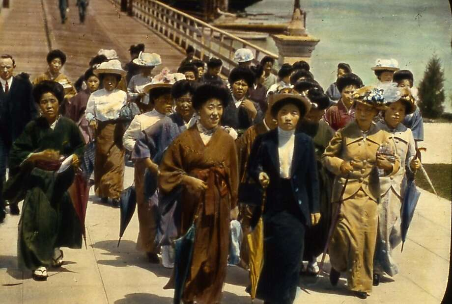 "ANGELISLAND_DISEMBARKING Japanese immigrants arrive at Angel Island Immigration Station. About 60,000 people from Japan, including about 20,000 ""picture brides,"" passed through the station between 1910 when the station opened and 1924 when Asian immigration was banned.   Credit: California State Parks Collection Note regarding retouching: The photos were provided retouched and it is not believed that it was done by either the Angel Island Immigration Station Foundation or the California State Parks Collection. Ran on: 09-14-2006 Don Nakahata, a UCSF professor, holds a ledger chronicling the arranged marriages of &quo;picture brides&quo; performed by his grandfather in the early 1900s. Ran on: 09-14-2006 Don Nakahata, a UCSF professor, holds a ledger chronicling the arranged marriages of &quo;picture brides&quo; performed by his grandfather in the early 1900s.  Ran on: 01-21-2010 Japanese women arrive at Angel Island early last century. Some 70,000 Japanese were detained there. Photo: Courtesy, CA State Parks Collection"