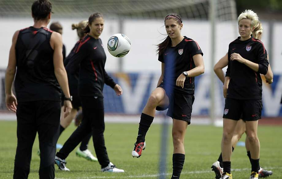 United States', from left, Abby Wambach, Carli Lloyd, Alex Morgan and Megan Rapinoe go through drills during a training session in preparation for the final match against Japan during the WomenÍs Soccer World Cup in Frankfurt, Germany, Friday, July 15, 2011. (AP Photo/Marcio Jose Sanchez)  Ran on: 07-17-2011 Alex Morgan (second from right), becoming known for her exuberant celebrations, prepares for today's World Cup final with Abby Wambach (left), Carli Lloyd and Megan Rapinoe. Photo: Marcio Jose Sanchez, AP