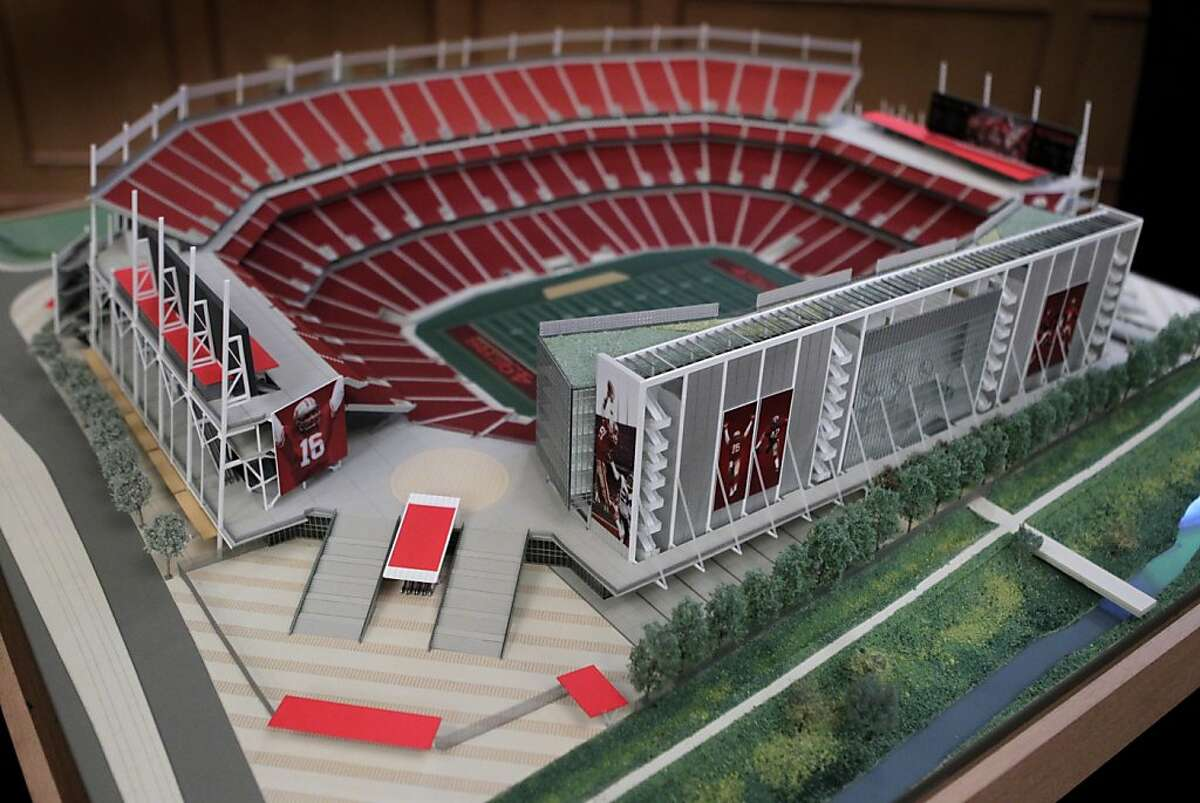 San Francisco 49ers team officials unveil a model and illustrations of the proposed stadium in Santa Clara, Calif. on Wednesday, August 3, 2011. The main entrance of the stadium leads to an elevated plaza from Tasman Drive.