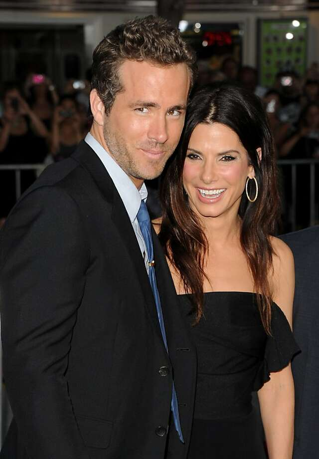 "LOS ANGELES, CA - AUGUST 01:  Actors Ryan Reynolds (L) and Sandra Bullock arrive at the premiere of Universal Pictures' ""The Change-Up"" held at the Regency Village Theatre on August 1, 2011 in Los Angeles, California. Photo: Jason Merritt, Getty Images"