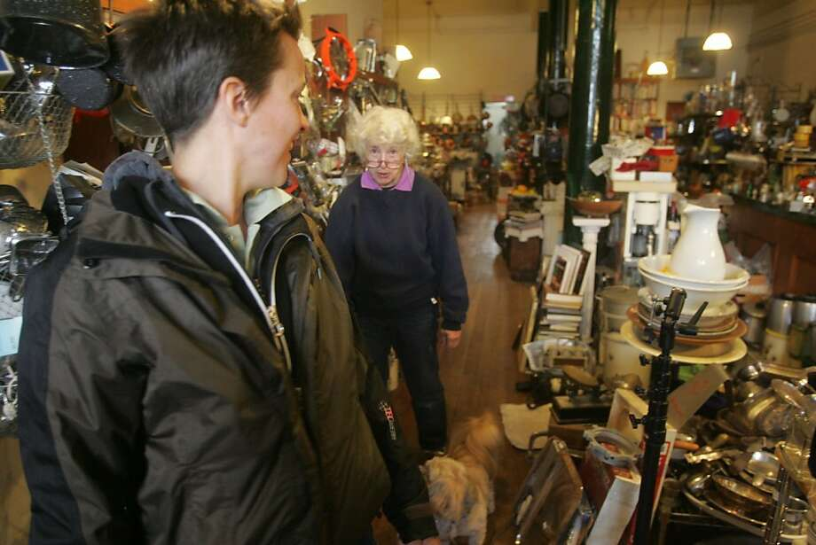 Judith Kaminsky, owner of Cookin', talks with customer Julia Lang in her second-hand gourmet cooking store on Divisadero. Photo: Mathew Sumner, Special To The Chronicle