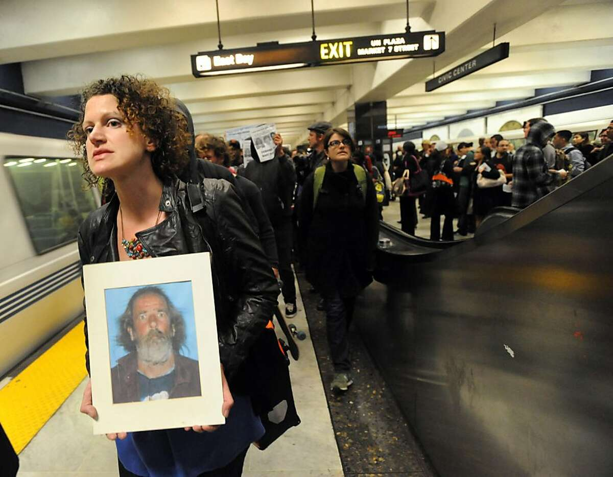 Laura Wolterstorff holds a photo of Charles Hill as she and other demonstrators gathered at the Civic Center Platform on July 11, 2011. The protest was held where Hill was killed by BART police on July 2, 2011. Ran on: 07-13-2011 Photo caption Dummy text goes here. Dummy text goes here. Dummy text goes here. Dummy text goes here. Dummy text goes here. Dummy text goes here. Dummy text goes here. Dummy text goes here.###Photo: bart13_PH1310256000SFC###Live Caption:Laura Wolterstorff holds a photo of Charles Hill as she and other demonstrators gathered at the Civic Center Platform on July 11, 2011. The protest was held where Hill was killed by BART police on July 2, 2011.###Caption History:Laura Wolterstorff holds a photo of Charles Hill as she and other demonstrators gathered at the Civic Center Platform on July 11, 2011. The protest was held where Hill was killed by BART police on July 2, 2011.###Notes:###Special Instructions:**MANDATORY CREDIT FOR PHOTOG AND SF CHRONICLE-NO SALES-MAGS OUT-TV OUT-INTERNET: AP MEMBER NEWSPAPERS ONLY** Ran on: 07-13-2011 Photo caption Dummy text goes here. Dummy text goes here. Dummy text goes here. Dummy text goes here. Dummy text goes here. Dummy text goes here. Dummy text goes here. Dummy text goes here.###Photo: bart13_PH1310256000SFC###Live Caption:Laura Wolterstorff holds a photo of Charles Hill as she and other demonstrators gathered at the Civic Center Platform on July 11, 2011. The protest was held where Hill was killed by BART police on July 2, 2011.###Caption History:Laura Wolterstorff holds a photo of Charles Hill as she and other demonstrators gathered...