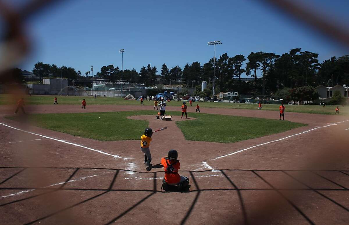 The Junior Giants play a game of baseball at Westlake Park on Friday, July 1, 2011 in Daly City, Calif. The Giants Community Fund, which will be 20 years old this month, runs the Junior Giants.