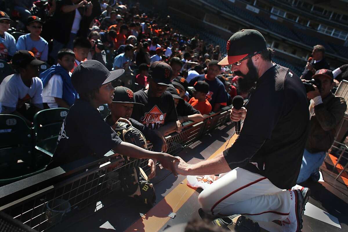 San Francisco Giants closer Brian Wilson shakes the hand of a young fan as he hands out gloves to youth from the Giant's Community Fund's Junior Giants baseball program at AT&T Park on Thursday, July 7, 2011 in San Francisco, Calif. Wilson treated over 1000 children to a question and answer session, tickets to the Giants/Padres game and a new Wilson baseball glove. The children are members of Junior Giants leagues from the Bayview Hunter's Point YMCA, Boys & Girls Clubs of San Francisco, San Francisco Police Activities League and San Francisco Recreation & Parks Department.