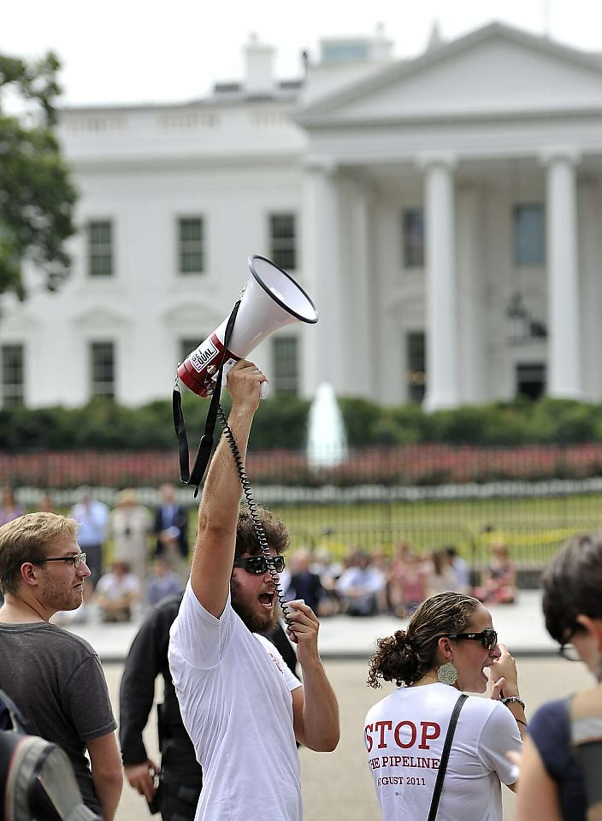 A protester uses a megaphone to shout slogans in front of the White House, on August 26, 2011 in Washington, DC. Demonstrators protested against the proposed Keystone XL oil pipeline project which, if approved, would run from Alberta, Canada to Texas. According the protester the greatest concern would be a spill in environmentally sensitive areas, such as wetlands, flowing streams and rivers, and areas with populations of sensitive wildlife or plant species. AFP PHOTO/ Mladen ANTONOV (Photo credit should read MLADEN ANTONOV/AFP/Getty Images)