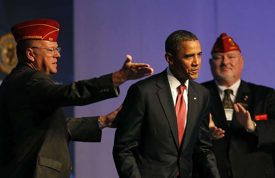 President Barack Obama is introduced by American Legion National Commander Jimmy Foster, left, as he prepared to speak about the service of U.S. troops in the decade after the Sept. 11 attacks to The American Legion 93rd National Convention, Tuesday, August 30, 2011, in Minneapolis, Minnesota. (Brian Peterson/Minneapolis Star Tribune/MCT) Photo: Brian Peterson, MCT