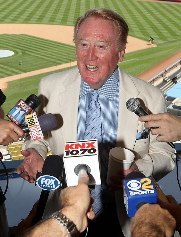 Vin Scully answers questions in his booth at Dodger Stadium during a news conference in Los Angeles, Sunday, Aug. 22, 2010. Scully will return to the broadcast booth to call Los Angeles Dodgers games next year for his 62nd season. The team said Sunday that the 82-year-old Hall-of-Famer will call all home games and road games against National League West opponents. (AP Photo/San Gabriel ValleyTribune, Keith Birmingham) ** MAGS OUT, NO SALES **  Ran on: 08-23-2010 Photo caption Dummy text goes here. Dummy text goes here. Dummy text goes here. Dummy text goes here. Dummy text goes here. Dummy text goes here. Dummy text goes here. Dummy text goes here.###Photo: names23_PH1_scully1202860800San Gabriel ValleyTribune###Live Caption:Vin Scully answers questions in his booth at Dodger Stadium during a news conference in Los Angeles, Sunday, Aug. 22, 2010. Scully will return to the broadcast booth to call Los Angeles Dodgers games next year for his 62nd season. The team said Sunday that the 82-year-old Hall-of-Famer will call all home games and road games against National League West opponents.###Caption History:Vin Scully answers questions in his booth at Dodger Stadium during a news conference in Los Angeles, Sunday, Aug. 22, 2010. Scully will return to the broadcast booth to call Los Angeles Dodgers games next year for his 62nd season. The team said Sunday that the 82-year-old Hall-of-Famer will call all home games and road games against National League West opponents. (AP Photo-San Gabriel ValleyTribune, Keith Birmingham) ** MAGS OUT, NO SALES **###Notes:SCULLY###Special Instructions:MAGS OUT, NO SALES  Ran on: 08-27-2011 Vin Scully started his career when the Dodgers were in Brooklyn. Photo: Keith Birmingham, AP