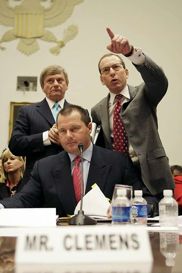 ** CORRECTS SPELLING OF LANNY BREUER ** Former New York Yankees baseball pitcher Roger Clemens, center, listens as his attorney's Rusty Hardin, left, and Lanny Breuer, right, try to address members questions during testimony on Capitol Hill in Washington, Wednesday, Feb. 13, 2008, before the House Oversight, and Government Reform committee hearing on drug use in baseball. (AP Photo/Pablo Martinez Monsivais) Ran on: 02-14-2008 Roger Clemens sits and listens as attorneys Rusty Hardin (left) and Lanny Breuer try to address committee members' questions during testimony on Capitol Hill. Ran on: 02-14-2008 Roger Clemens  listens as attorneys Rusty Hardin (left) and Lanny Breuer try to address House Oversight Committee members' questions during testimony on Capitol Hill.  Ran on: 08-31-2011 Assistant U.S. Attorney General Lanny Breuer. Ran on: 08-31-2011 Assistant U.S. Attorney General Lanny Breuer. Ran on: 08-31-2011 Assistant U.S. Attorney General Lanny Breuer. Photo: Pablo Martinez Monsivais, AP