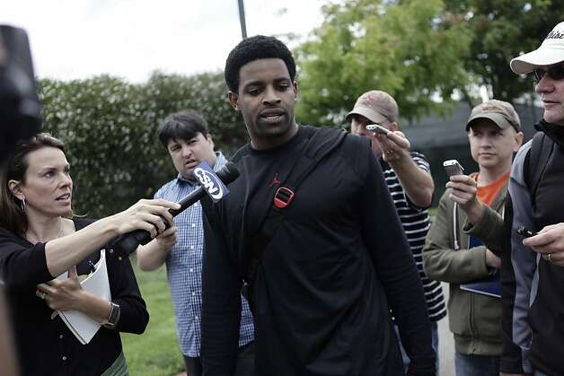 Michael Crabtree is surrounded by the media following a closed mini-camp in Spartan Stadium at San Jose State University in San Jose on June 6, 2011.(AP Photo/Mercury News, Gary Reyes)  Ran on: 06-12-2011 All that stands between Michael Crabtree and eccentricity are some actual accomplishments. Well, that and his sore feet. Ran on: 06-12-2011 All that stands between Michael Crabtree and eccentricity are some actual accomplishments. Well, that and his sore feet. Photo: Gary Reyes, AP