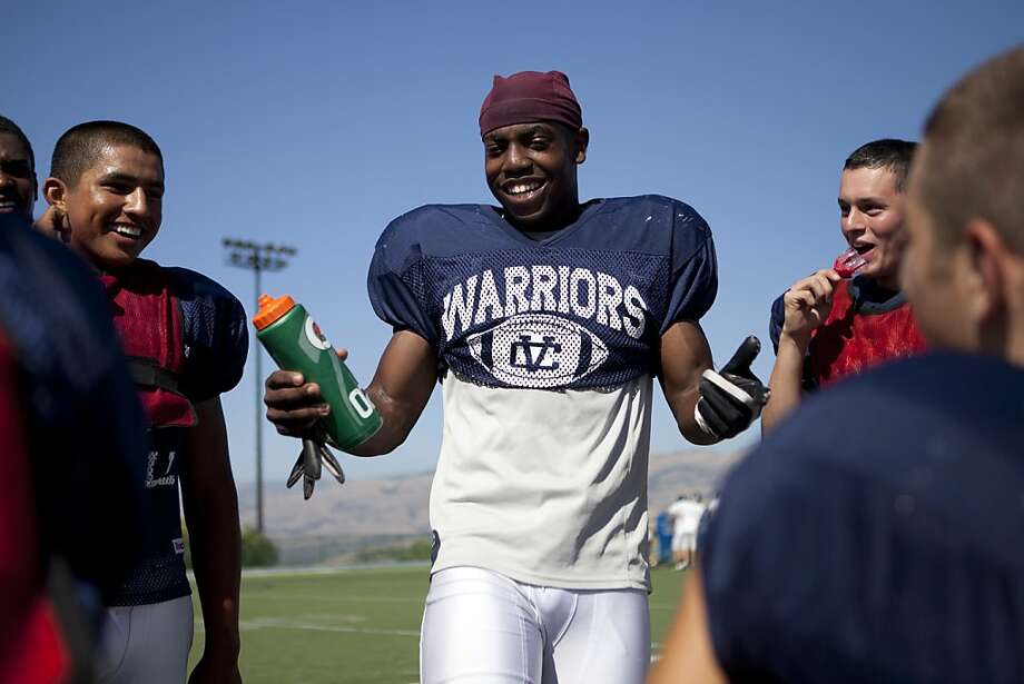 Running back Byron Marshall, 17, jokes with his teammates during a break from practice at the Valley Christian football field on Monday, August 29, 2011 in San Jose, Calif.  Marshall is one of the top 50 recruits in the nation. Photo: John Sebastian Russo, Special To The Chronicle