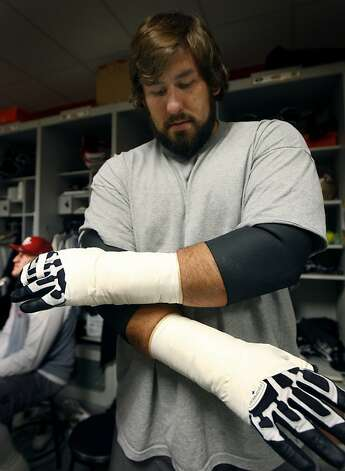 San Francisco 49ers offensive tackle Adam Snyder admires his handiwork  when he finished taping his hands before practice in Santa Clara, Calif., on Thursday, Dec. 10, 2009. Photo: Paul Chinn, The Chronicle
