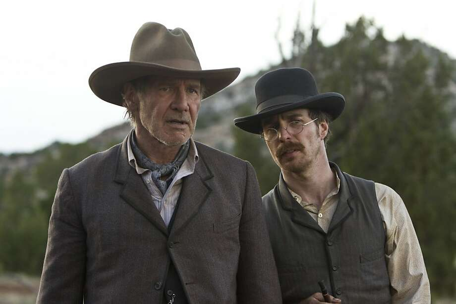 "In this publicity image released by Universal Pictures, Harrison Ford, left, and Sam Rockwell are shown in a scene from ""Cowboys & Aliens."" (AP Photo/Universal Pictures, Zade Rosenthal) Photo: Zade Rosenthal, AP"
