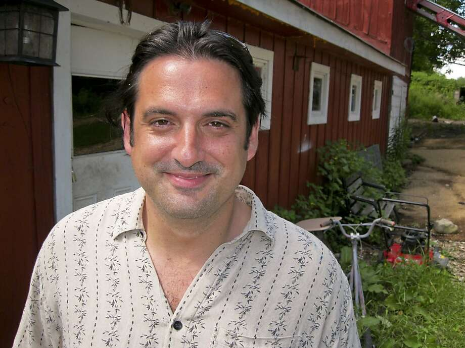 Paul Ceglia poses for a photo outside his home in Wellsville, New York, U.S., on Thursday, July 29, 2010. Ceglia sued Facebook and its founder and Chief Executive Officer Mark Zuckerberg in New York state court, claiming that an April 2003 agreement entitles him to ownership of most of the privately held company. Photographer: Bob van Voris/Bloomberg *** Local Caption *** Paul Ceglia  Ran on: 08-03-2010 Paul Ceglia says he owns an 84 percent share of Facebook.  Ran on: 09-05-2010 Paul Ceglia, suing for a big piece of Facebook, is at his New York home.   Ran on: 04-13-2011 Paul Ceglia claims he is owed 84 percent of Facebook.   Ran on: 05-27-2011 Paul Ceglia says he and Facebook founder Mark Zuckerberg had a deal.  Ran on: 06-25-2011 Paul Ceglia sued for ownership of half of Facebook. Ran on: 06-25-2011 Paul Ceglia sued for ownership of half of Facebook. Photo: Bob Van Voris, Bloomberg