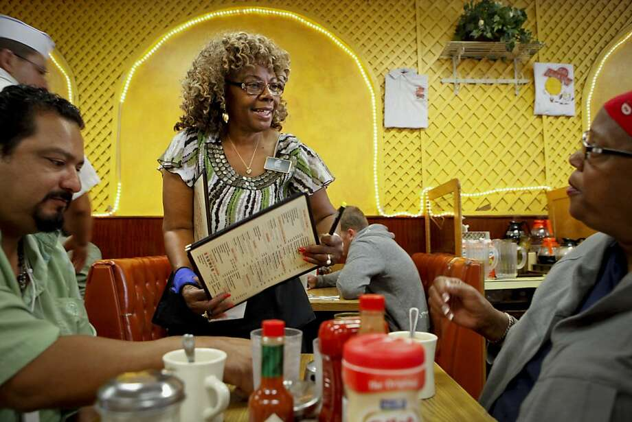 Dolores Jeanpierre takes an order from Ole's Waffle Shop customers, Jose Tarrango and Cindy Jones on Friday, Aug. 19, 2011 in Alameda, Calif. Photo: Russell Yip, The Chronicle