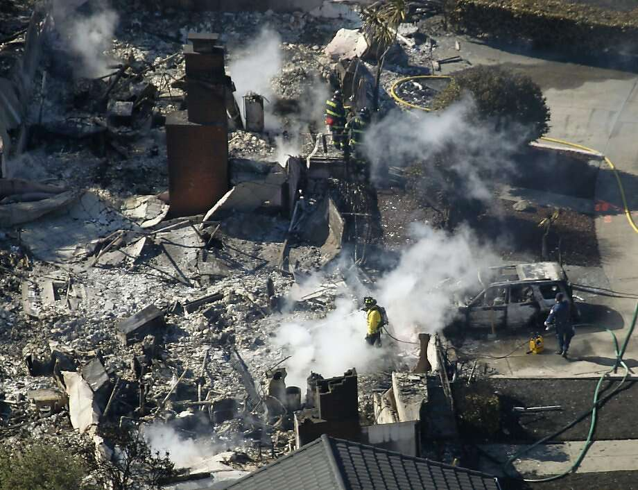 Fire crews put out hot spots at a home in San Bruno, Calif. on Friday, Sept. 10, 2010 that was destroyed after a massive natural gas pipeline explosion Thursday night. Photo: Paul Chinn, The Chronicle