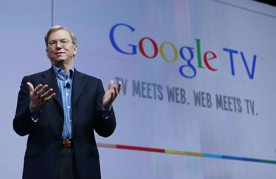 Google CEO Eric Schmidt talks about Google TV at the Google conference in San Francisco, Thursday, May 20, 2010. Google Inc. believes it has come up with the technology to unite Web surfing with channel surfing on televisions.(AP Photo/Paul Sakuma)  Ran on: 05-21-2010 Google CEO Eric Schmidt says his company faced challenges merging Internet technology with &quo;50-year-old&quo; TV technology.  Ran on: 08-15-2010 Google CEO Eric Schmidt is leading efforts to integrate channel and Web surfing to reach audiences. Photo: Paul Sakuma, AP