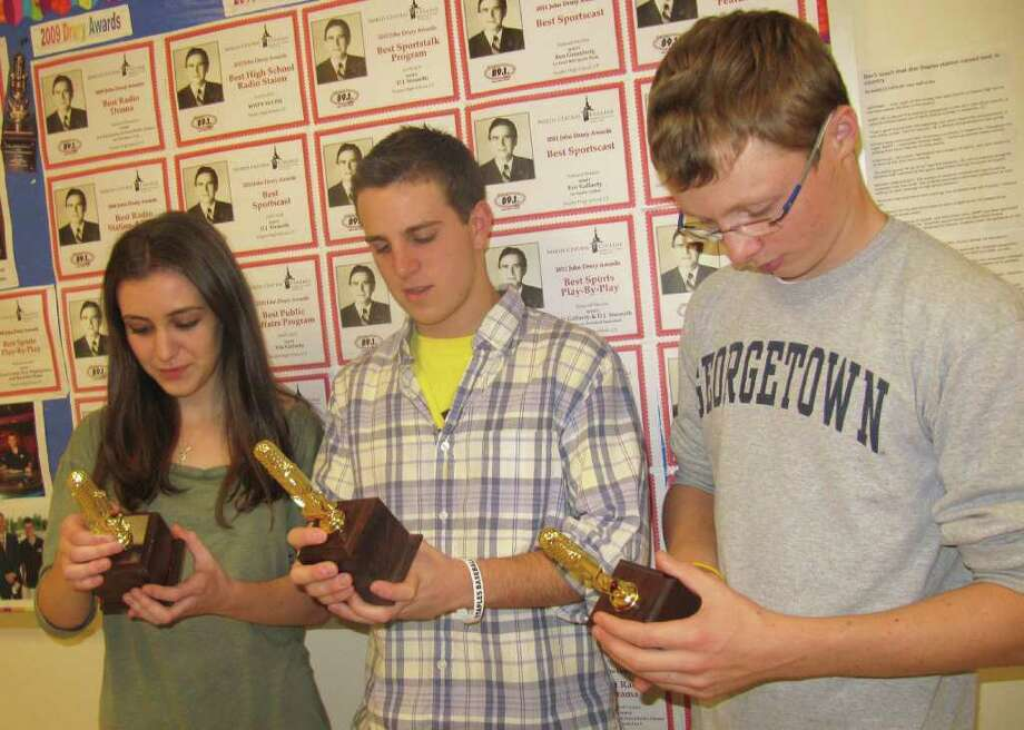 From left to right, Hannah Foley, Ben Greenberg and Brendan Burris all won individual awards that helped Staples High School's radio station (WWPT) earn recognition Saturday as the best high school station in the nation. Other students not pictured also won individual awards.  Foley, Greenberg and Burris were photographed Wednesday outside Staples' media lab, where their new award certificates were hung next to last's year's honors. Photo: Kirk Lang