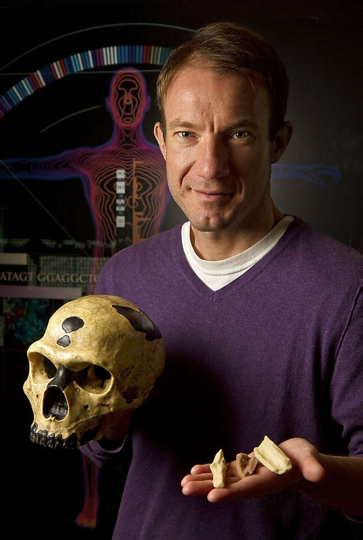 This undated handout photo provided by the journal Science shows University of California Santa Cruz professor of biomolecular engineering Ed Green holding replicas of the bones, and a skull, from which Neanderthal DNA was extracted for genome sequencing. (AP Photo/Jim MacKenzie, UC-Santa Cruz) Ran on: 05-07-2010 UC Santa Cruz Professor Richard E. Green holds replicas of the Neanderthal bones DNA was extracted from. Ran on: 05-07-2010 UC Santa Cruz Professor Richard E. Green holds replicas of the Neanderthal bones DNA was extracted from.