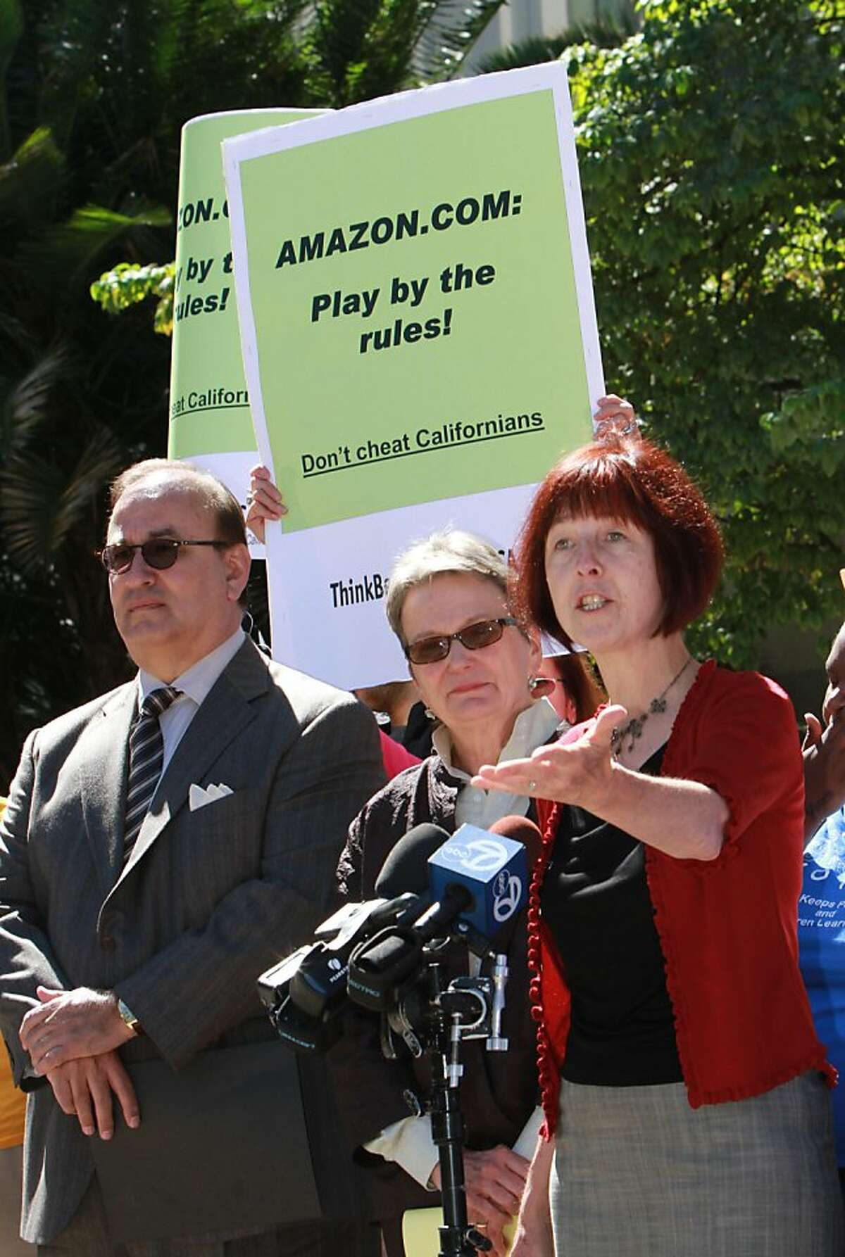 Assemblywoman Nancy Skinner, D-Berkeley, right called on clients of internet giant Amazon.com to cancel their accounts unless it stops resisting a new California law that requires more online retailers to collect state sales tax, during a news conference at the Capitol in Sacramento, Calif. Skinner, who authored the internet sales tax measure, was accompanied by Assemblyman Charles Calderon, D-Whittier, left, and state Sen. Loni Hancock, D-Berekeley, in calling on Amazon to stop its effort to repeal the law through a ballot referendum next year. (AP Photo/Rich Pedroncelli)