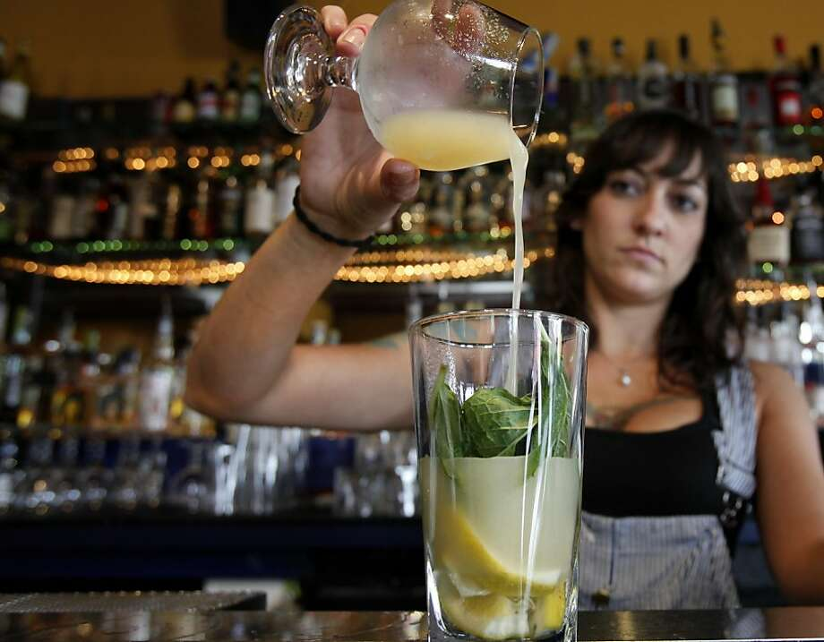Bartender Amber Triolo of Mars Bar adds ginger to a cocktail.  She would infuse ginger with alcohol if the new law is passed. At Mars Bar and Restaurant in San Francisco, Calif. bartender Amber Triolo makes her drinks fresh, but would like to infuse alcohol if it becomes legal in the state. The California State legislature is debating a new measure which would allow bars to legally infuse alcohol with fruit and herbs. Photo: Brant Ward, The Chronicle
