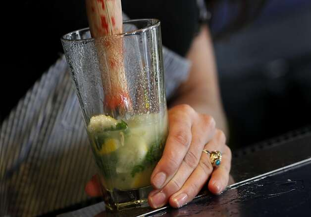 "Bartenders like Amber Triolo have to ""muddle"" or mix fresh ingredients now, infusing would make the job easier and perhaps tastier. At Mars Bar and Restaurant in San Francisco, Calif. bartender Amber Triolo makes her drinks fresh, but would like to infuse alcohol if it becomes legal in the state. The California State legislature is debating a new measure which would allow bars to legally infuse alcohol with fruit and herbs. Photo: Brant Ward, The Chronicle"