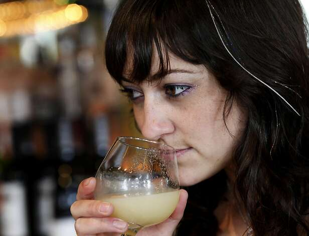 Bartender Amber Triolo of Mars Bar smells fresh ginger juice they make at the bar.  She would like to infuse the ginger with alcohol if given the chance. At Mars Bar and Restaurant in San Francisco, Calif. bartender Amber Triolo makes her drinks fresh, but would like to infuse alcohol if it becomes legal in the state. The California State legislature is debating a new measure which would allow bars to legally infuse alcohol with fruit and herbs. Photo: Brant Ward, The Chronicle