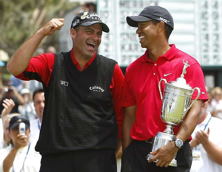 Tiger Woods (R) of the U.S. holds the trophy as he talks with Rocco Mediate after winning the U.S. Open golf championship in a playoff at Torrey Pines in San Diego June 16, 2008.     REUTERS/Mike Blake (UNITED STATES) Ran on: 06-17-2008 Tiger Woods and Rocco Mediate have a light moment after their 19-hole playoff, though Woods enjoyed it more thanks to the U.S. Open trophy he was holding. Ran on: 06-17-2008 Tiger Woods and Rocco Mediate have a light moment after their 19-hole playoff, though Woods enjoyed it more thanks to the U.S. Open trophy he was holding. Ran on: 06-17-2008  Ran on: 02-01-2009 Tiger Woods may be holding the U.S. Open trophy, but a delighted Rocco Mediate caused golf fans to swoon over him after his outstanding effort in losing a playoff at Torrey Pines in 2008. Ran on: 02-01-2009  Ran on: 02-01-2009 Photo: Mike Blake, Reuters