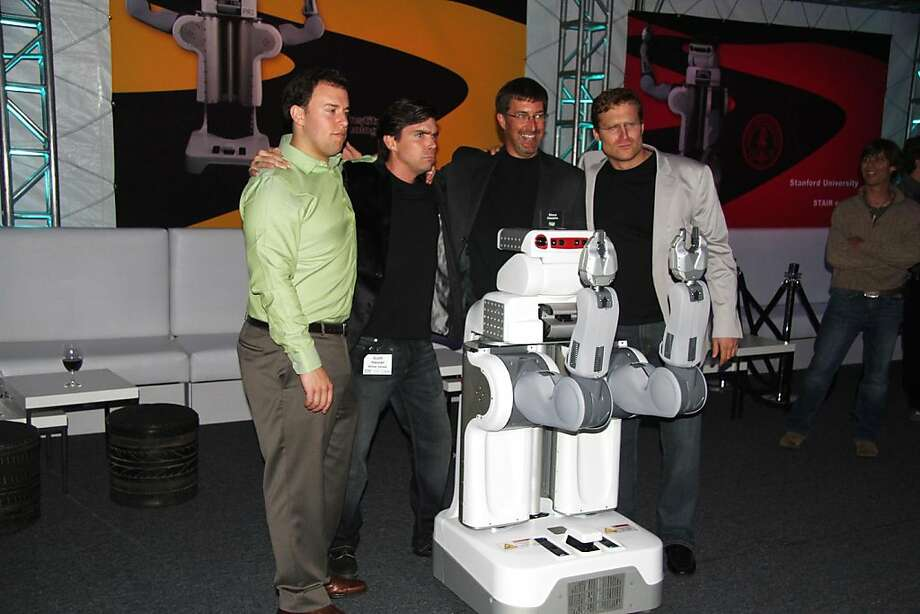 L TO R - Eric Berger Scott Hassan Steve Cousins and Keenan Wryobek with a robot at the Willow Garage robot graduation in Menlo Park.   Ran on: 05-30-2010 Eric Berger, Scott Hassan, Steve Cousins and Keenan Wryobek show off Personal Robot 2. Photo: Courtesy, Renee Blodgett