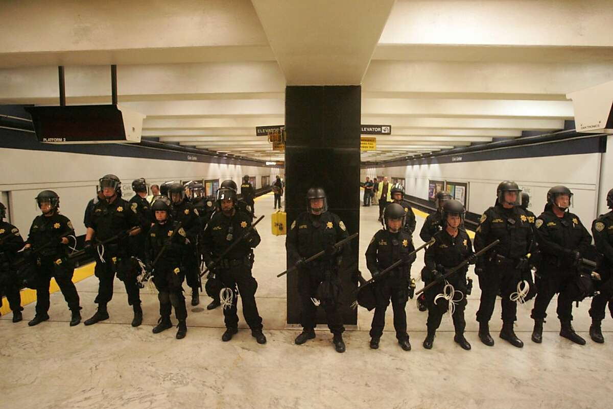 BART police line up to clear the Civic Center BART station during a protest against the BART Police. Ran on: 08-23-2011 BART police line up to clear the Civic Center Station during a protest over a shooting and subsequent wireless blackout.
