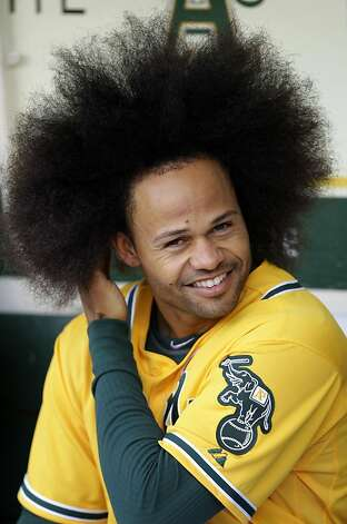 Oakland Athletics' Coco Crisp runs his fingers through his hair in the dugout prior to a baseball game against the Detroit Tigers, Thursday, April 14, 2011, in Oakland, Calif. Photo: Ben Margot, AP