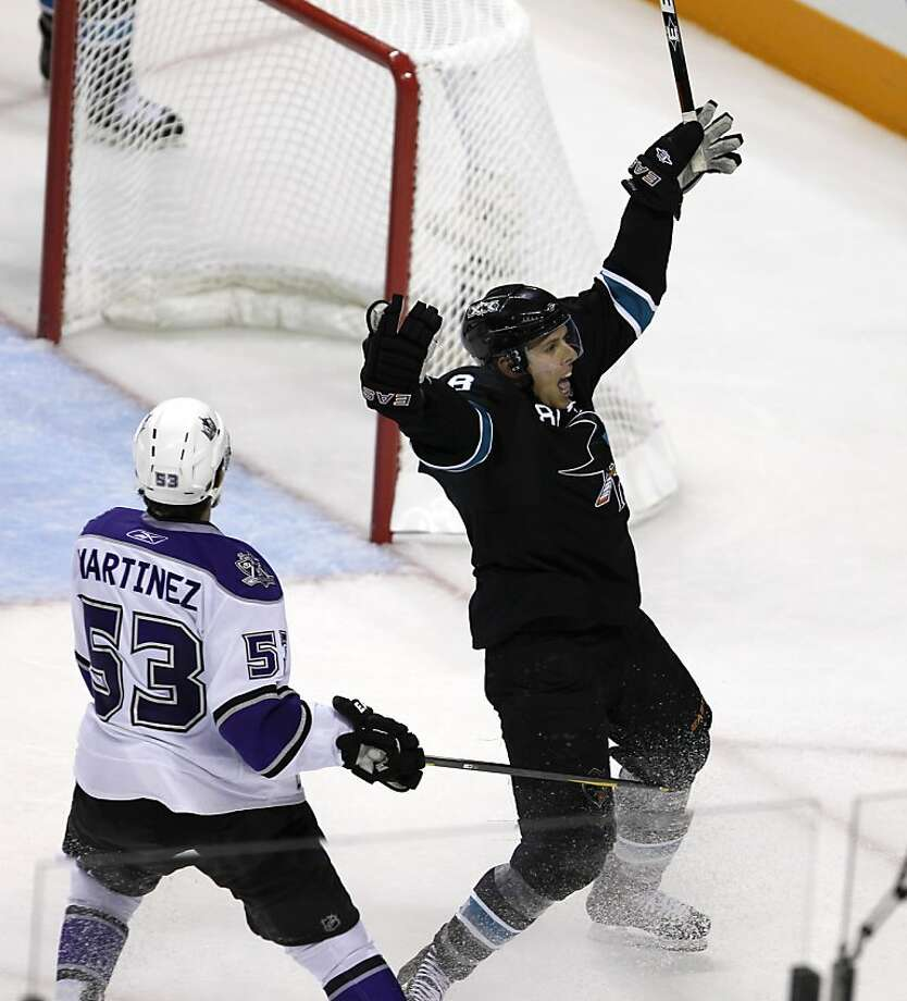 Joe Pavelski celebrates his game-winning goal in overtime of the San Jose Sharks game against the Los Angeles Kings in Game 1 of the NHL Western Conference quarterfinals in San Jose, Calif. on Thursday, April 14, 2011. Photo: Paul Chinn, The Chronicle