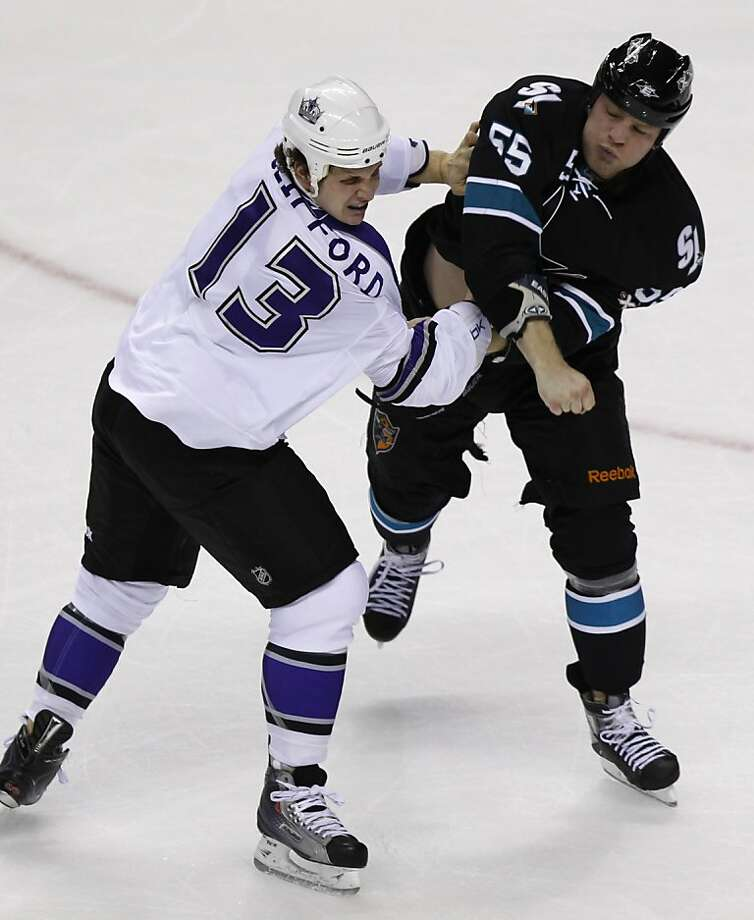 Kyle Clifford (left) and Ben Eager exchange blows in the first period of the San Jose Sharks game against the Los Angeles Kings in Game 1 of the NHL Western Conference quarterfinals in San Jose, Calif. on Thursday, April 14, 2011. Photo: Paul Chinn, The Chronicle