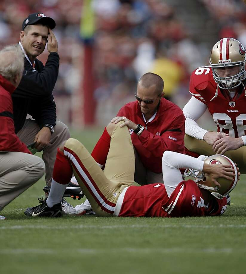 San Francisco 49ers punter Andy Lee (4) is checked out by medical, as the San Francisco 49ers take on the Oakland Raiders in preseason action at Candlestick Park in San Francisco, Calif. on Saturday August 20, 2011. Photo: Michael Macor, The Chronicle