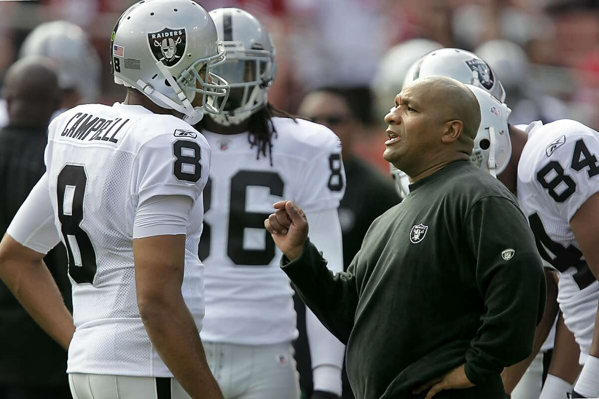 Oakland Raiders head coach Hue Jackson, (right) talks with his quarterback quarterback Jason Campbell (8) during pre-game warmups, as the San Francisco 49ers take on the Oakland Raiders in preseason action at Candlestick Park in San Francisco, Calif. on Saturday August 20, 2011.