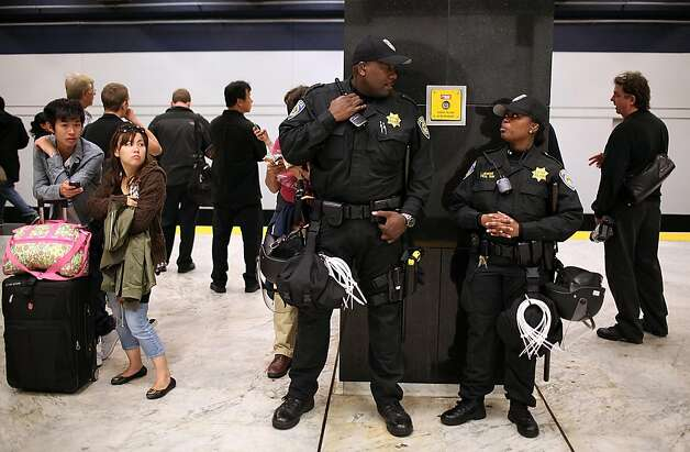 SAN FRANCISCO, CA - AUGUST 22:  Bay Area Rapid Transit (BART) police officers stands guard during a protest on the platform at the Civic Center station on August 22, 2011 in San Francisco, California. The hacker group 'Anonymous' staged a demonstration for the second week in a row at a BART station to protest BART's decision to turned off cell phone service in its stations during a disruptive protest a few weeks ago following a fatal shooting of a man by BART police.  (Photo by Justin Sullivan/Getty Images) *** BESTPIX *** Photo: Justin Sullivan, Getty Images
