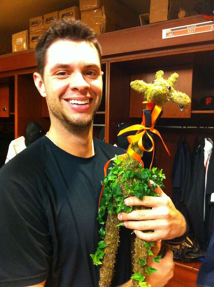 Brandon Belt poses on Aug. 25, 2011, in the Giants' clubhouse with a giraffe of ivy and moss made for him by a Marin County florist. Photo: Henry Schulman, The Chronicle