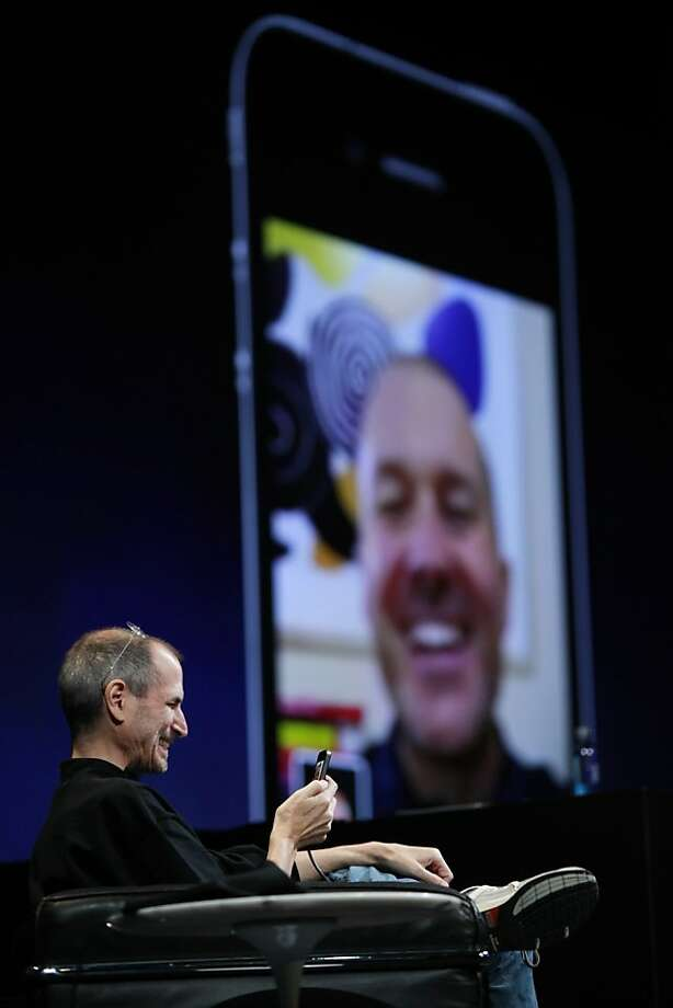 In this June 7, 2010 photo shows Apple CEO Steve Jobs with an iPhone using FaceTime with Jonathan Ive, Apple senior vice president of Industrial Design, at the Apple Worldwide Developers Conference, in San Francisco. (AP Photo/Paul Sakuma)  Ran on: 08-28-2011 Apple CEO Steve Jobs uses FaceTime on an iPhone with Jonathan Ive, Apple senior vice president of industrial design, at the Apple Worldwide Developers Conference last year. Photo: Paul Sakuma, AP