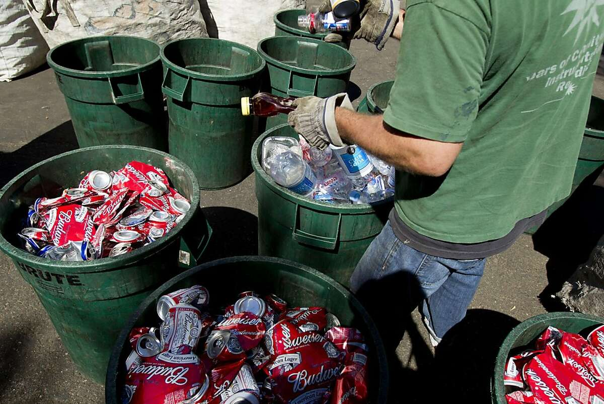 Chris Sandor, of the Haight-Ashbury Neighborhood Council Recycling Center, sorts various type of bottles and cans into different bins prior to weighting for a customer in San Francisco, Calif. on Wednesday, Sept. 1, 2010. Ran on: 09-02-2010 Chris Sandor sorts bottles and cans for a client of the ANC Recycling Center, which opened in Golden Gate Park in 1974.