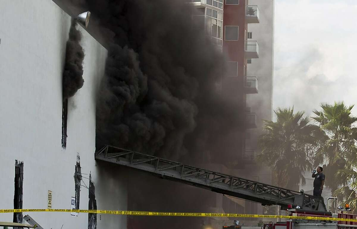 Smoke billows from the Casino Royale in Monterrey, Mexico, Thursday Aug. 25, 2011. Two dozen gunmen burst into the casino in northern Mexico on Thursday, doused it with a flammable liquid and started a fire that trapped gamblers inside, killing at least 32 people and injuring a dozen more, authorities said. (AP Photo/Hans Maximo Musielik)