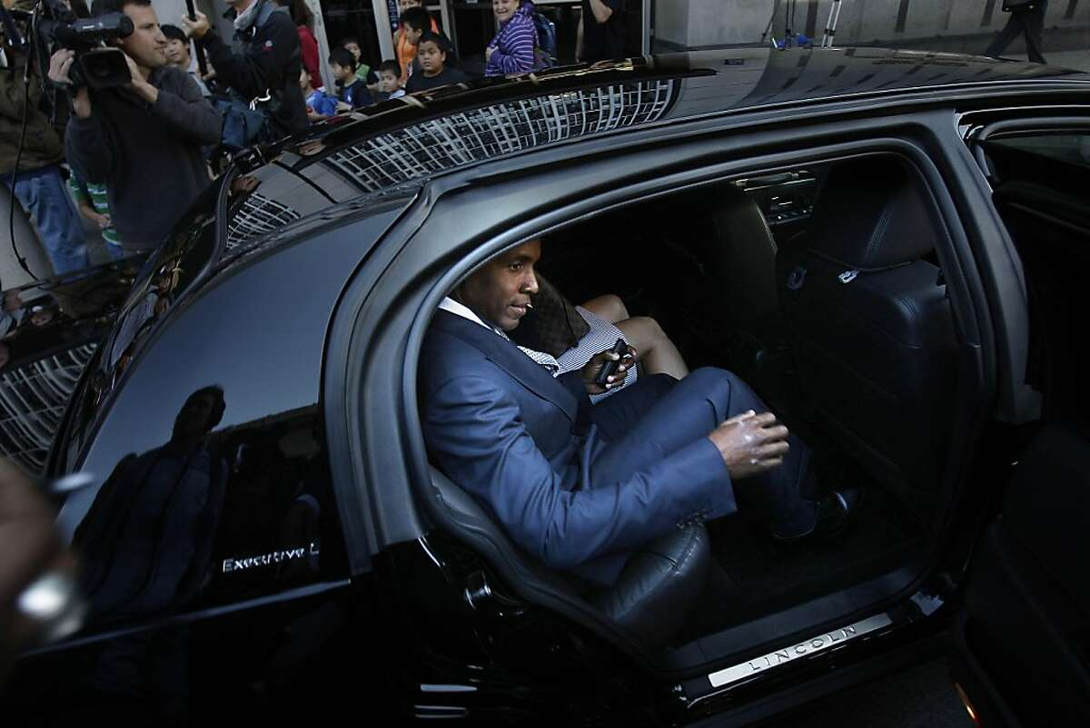 Barry Bonds leaves the Philip Burton Federal Building and Court House on Thursday, August 25, 2011 in San Francisco, Calif.