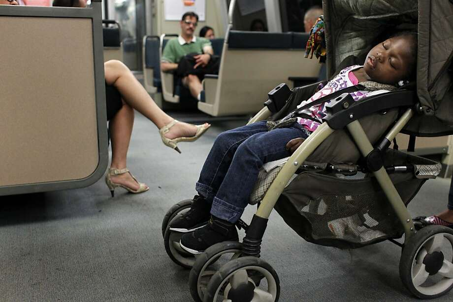 Danika Bolben, 3 years-old,  sleeps as her mother Tamanika Anderson prepares to get off the Bay Area Rapid Transit, BART, train, Tuesday August 23, 2011, in San Francisco, Calif. Photo: Lacy Atkins, The Chronicle