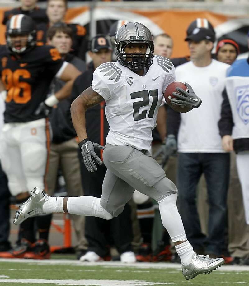 Oregon running back LaMichael James (21) runs down field in the first half of an NCAA college football game against Oregon State, Saturday, Dec. 4, 2010, in Corvallis, Ore. (AP Photo/Rick Bowmer)  Ran on: 12-05-2010 Photo caption Dummy text goes here. Dummy text goes here. Dummy text goes here. Dummy text goes here. Dummy text goes here. Dummy text goes here. Dummy text goes here. Dummy text goes here.###Photo: colfbbox05_PH_oregon1291334400AP###Live Caption:Oregon running back LaMichael James (21) runs down field in the first half of an NCAA college football game against Oregon State, Saturday, Dec. 4, 2010, in Corvallis, Ore.###Caption History:Oregon running back LaMichael James (21) runs down field in the first half of an NCAA college football game against Oregon State, Saturday, Dec. 4, 2010, in Corvallis, Ore. (AP Photo-Rick Bowmer)###Notes:LaMichael James###Special Instructions: Photo: Rick Bowmer, AP